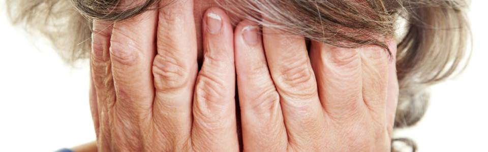 7752145 – a crying elderly woman covering her face